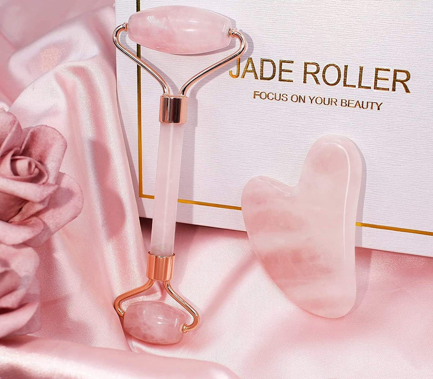 the double-sided roller next to a gua sha scraping tool