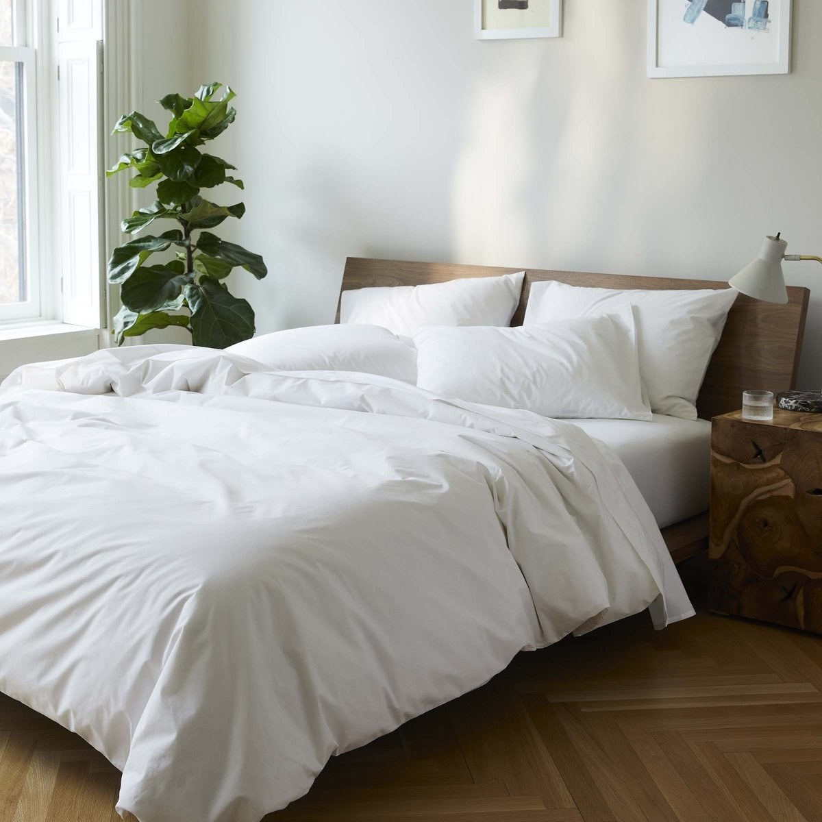 a bed dressed in the luxury bedding set bundle
