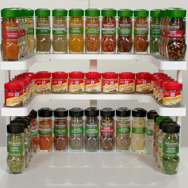 Set of Spicy Shelves installed in cabinet with spices placed on top