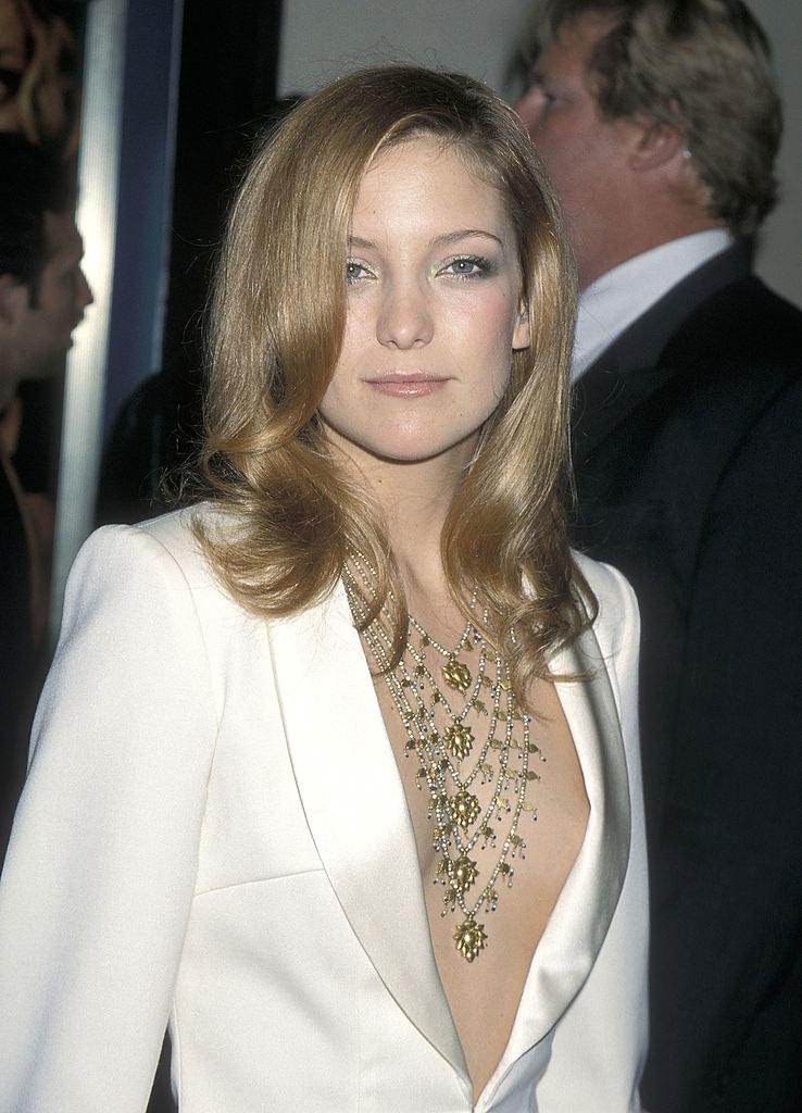 straight hair in a white blazer