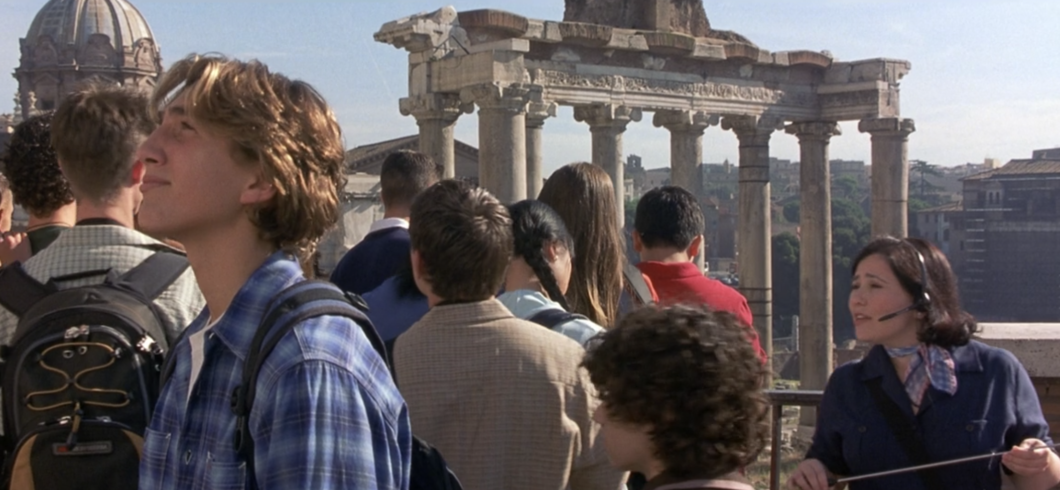 Ethan Craft walking by ruins in Rome