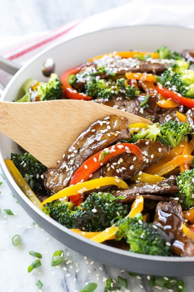 Beef and broccoli stir fry with peppers and sesame seeds.