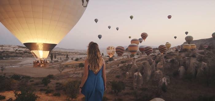 Hundreds of hot air balloons flying in Cappadocia in Turkey