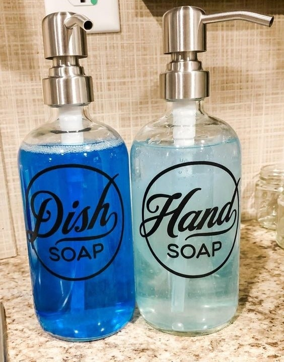 Reviewer's picture of their labeled bottles for hand soap and dish soap