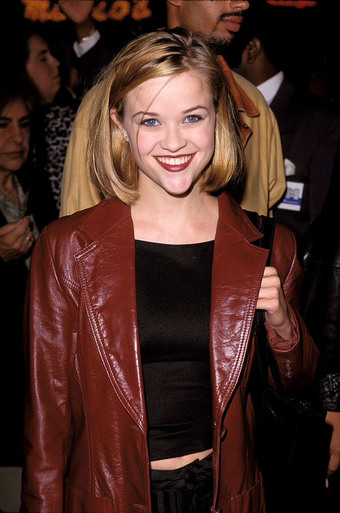 wearing a thick red leather jacket
