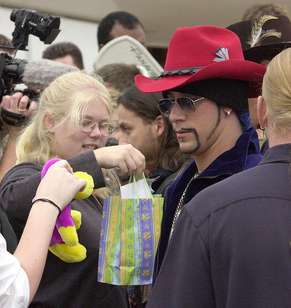 a girl giving aj from backstreet boys a gift