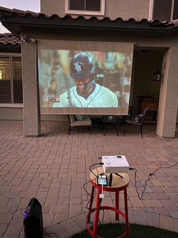 a reviewer's image of the projector showing a baseball game outside