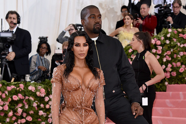 Kim and Kanye pose on the red carpet of the Met Gala