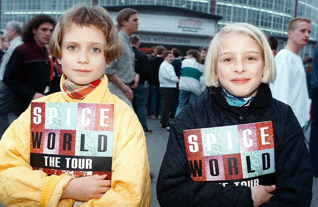 two girls holding spice girls books