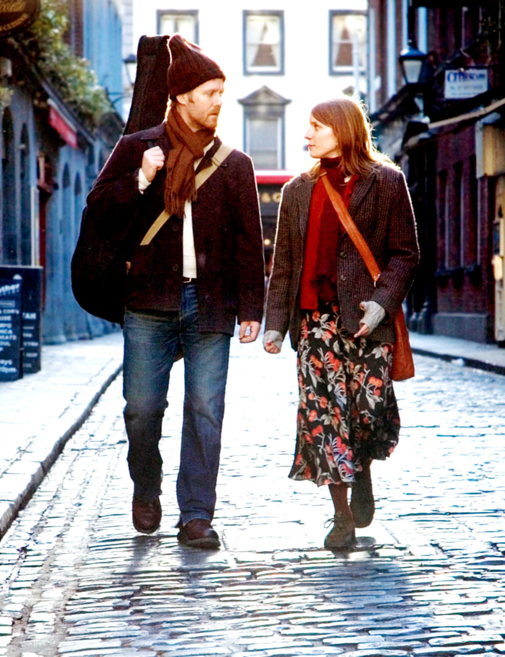A man and woman walking down a Dublin street