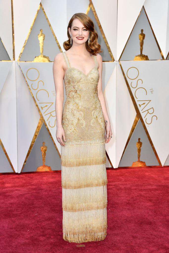 Emma in a Gatsby-era fringe gown