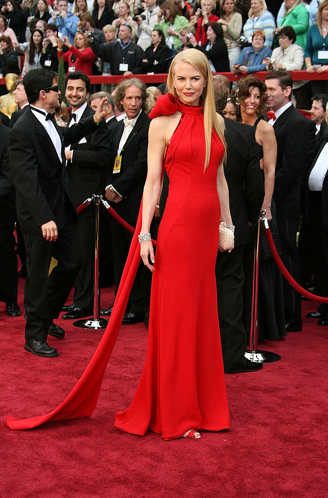 Nicole wearing a long gown with a large bow at the back of her neck that leads into a long train
