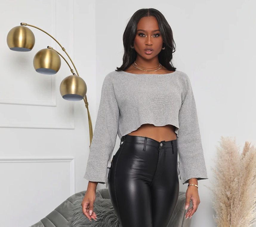 model wearing the gray knit crop top with black pants