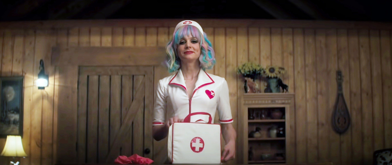 Cassie, dressed as a stripper nurse