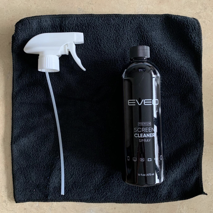 The spray bottle and black cloth