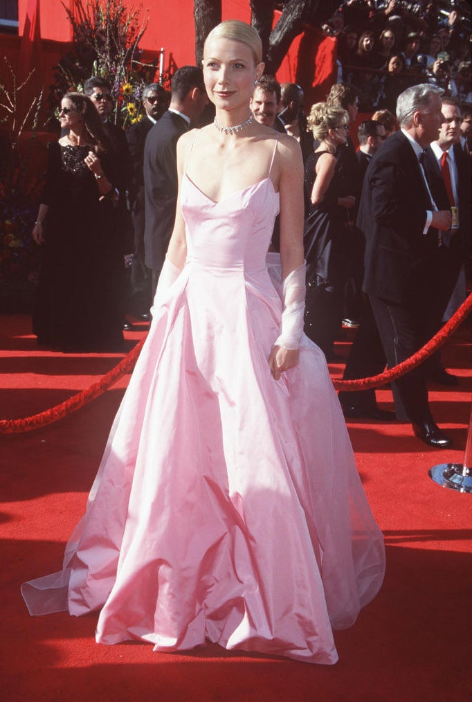 Gwyneth in a satin gown with spaghetti straps and a sweetheart neckline