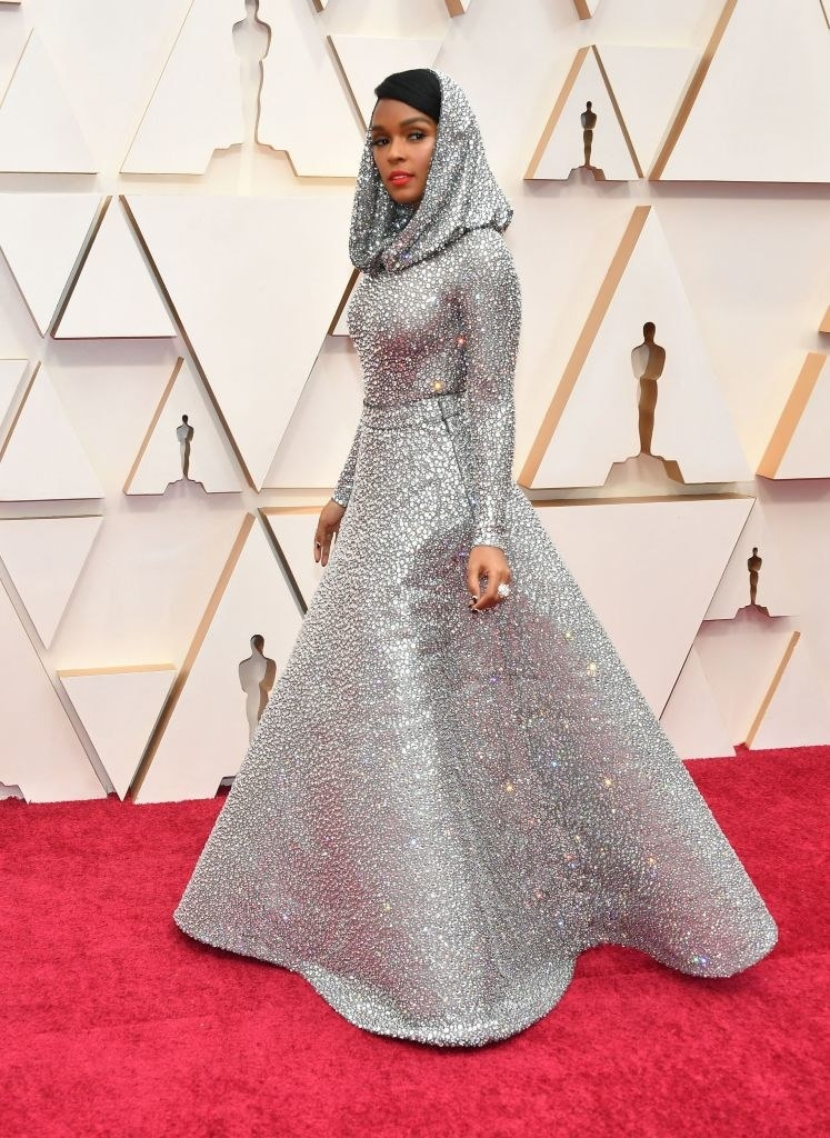 Janelle wearing a sparkly ballgown with a hood