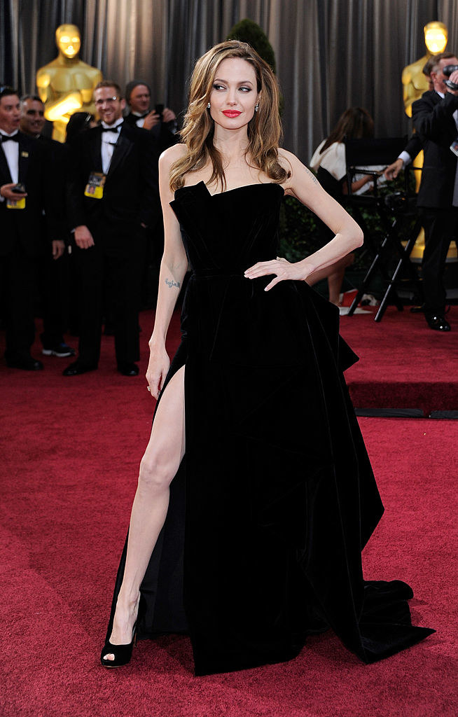 Angelina in a velvet gown with a thigh-high slight