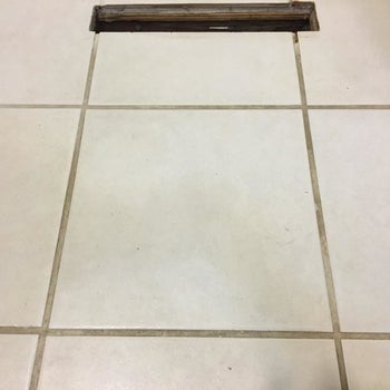 Reviewer's white tile and dark gray grout