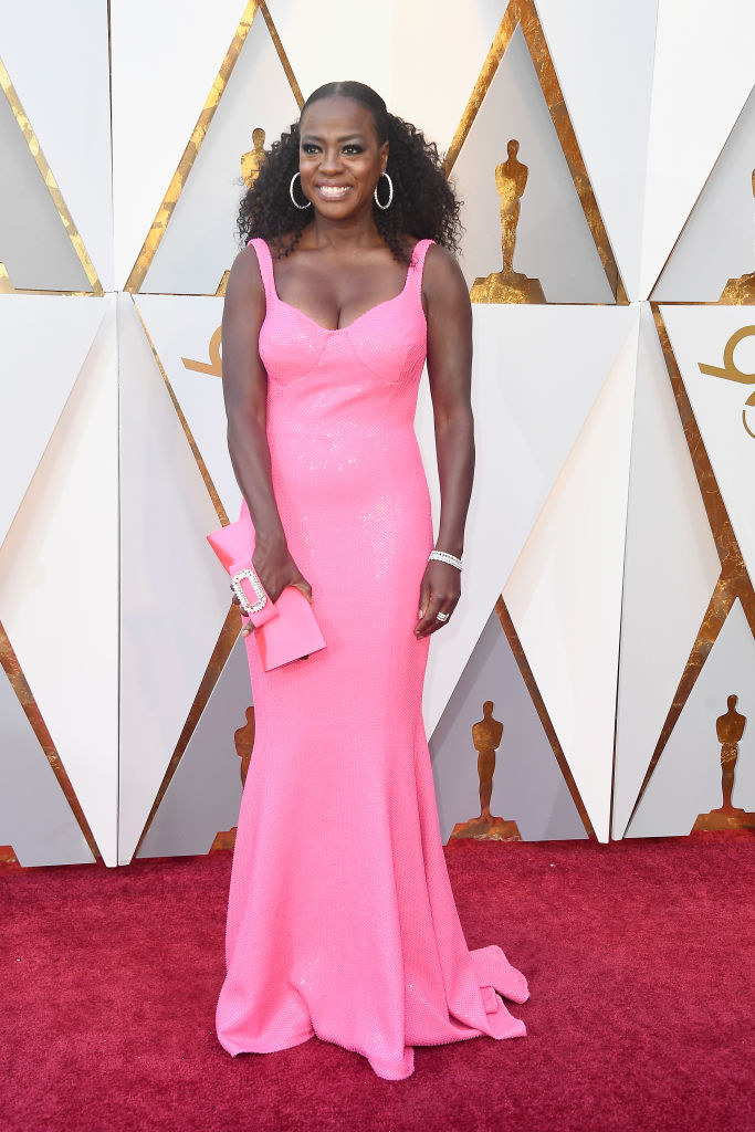 Viola in a pink gown and matching clutch