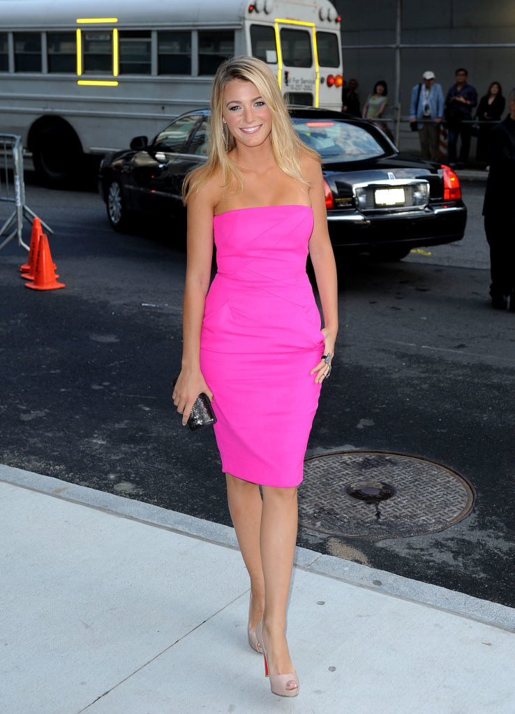 Blake Lively in a pink, strapless, tight dress that goes above the knees