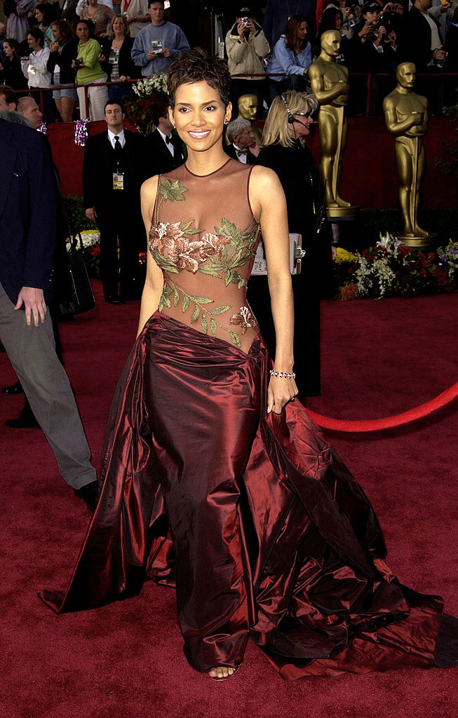 Halle in a ball gown with a see-through top with floral appliques