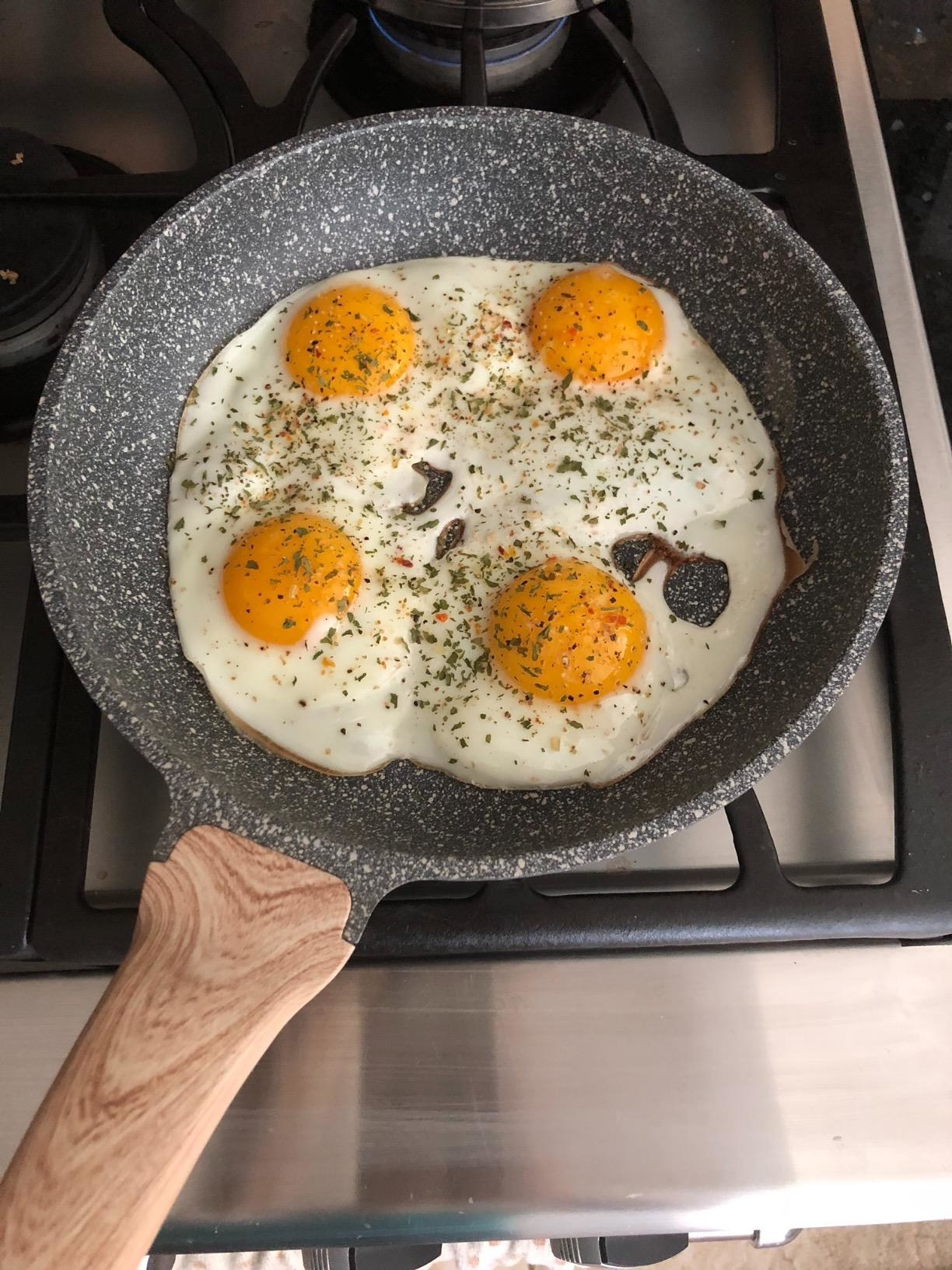 the pan with eggs and seasoning