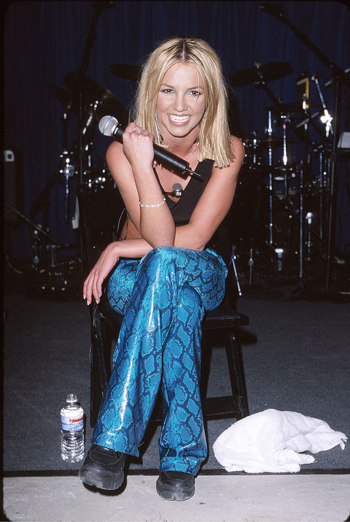 Britney in bright snakeskin leather pants