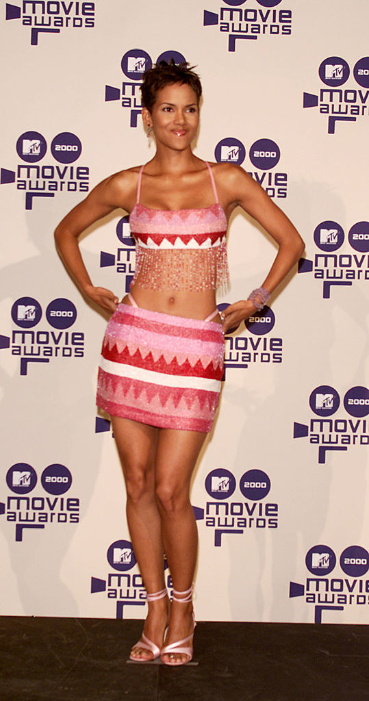 Halle Berry in a matching crop top and skirt, which has a whale-tail detail that looks like an exposed thong