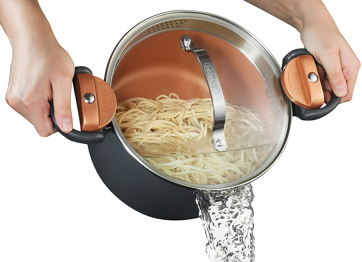 a pair of hands holding the pot as it drains