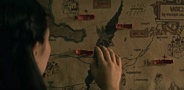 Alina studying a map with The Fold in the center