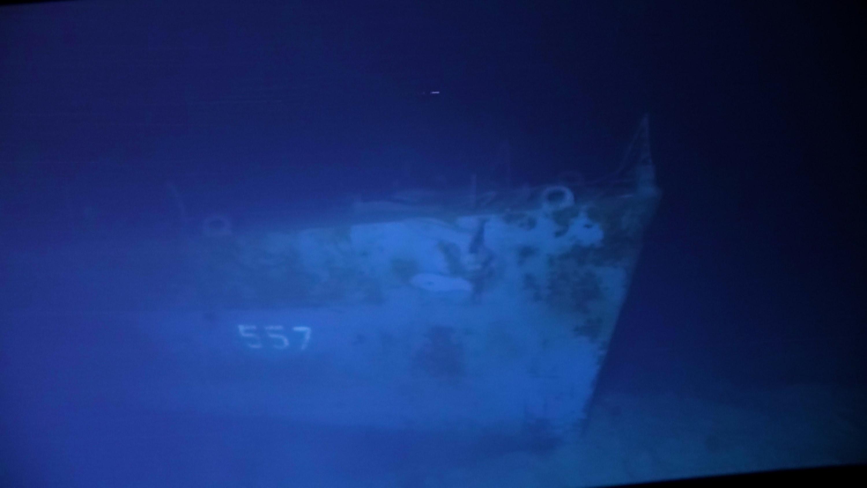 The USS Johnston barely visible on the dark ocean floor