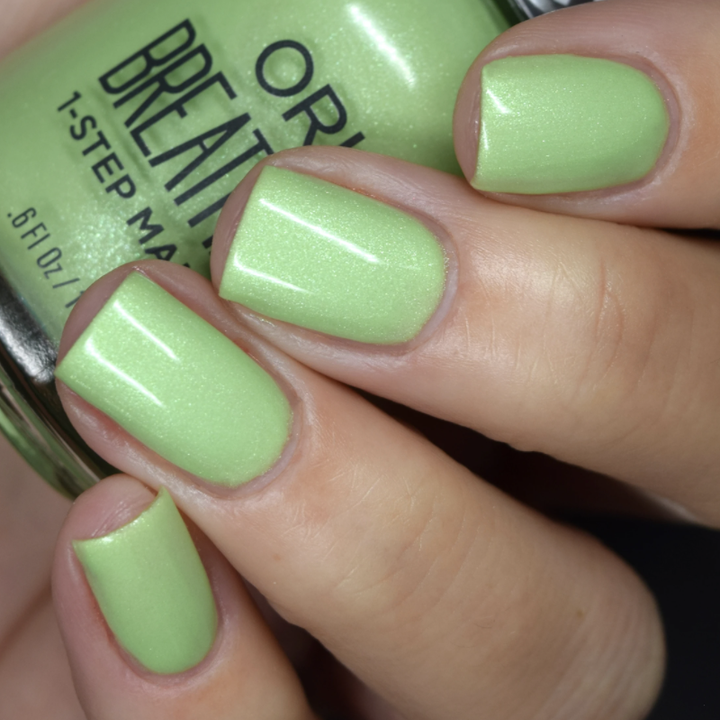 nails with the green nail polish on it