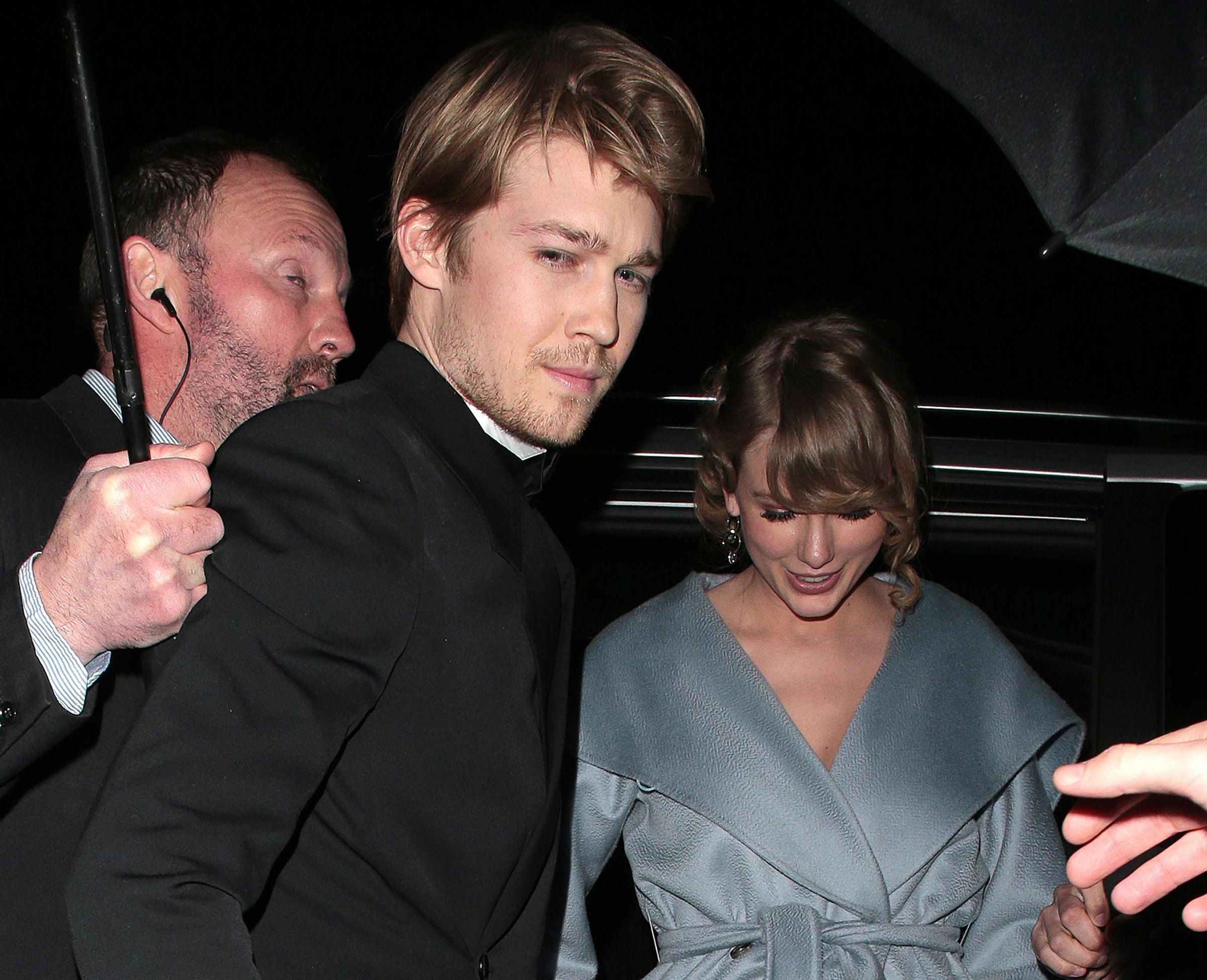 Joe helps Taylor exit a car