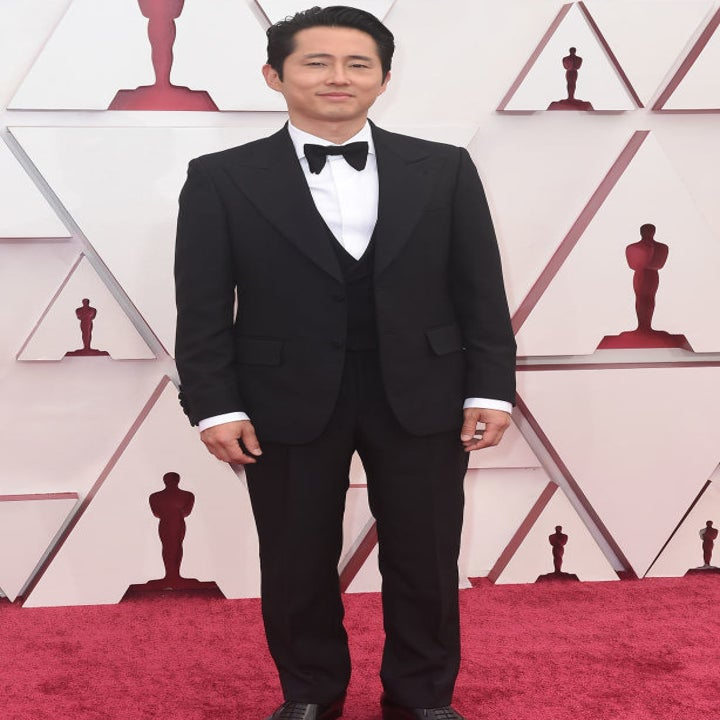 STEVEN YEUN in a black tux on the Oscar's red carpet