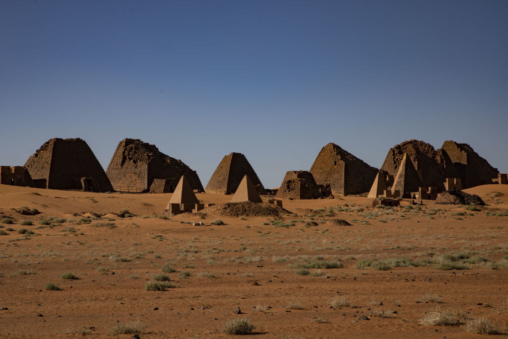 The pyramids out in the desert with the tops missing