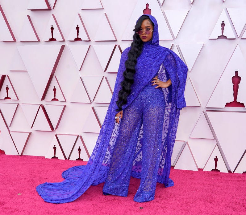 HER wore a see through lace purple jumpsuit with cape