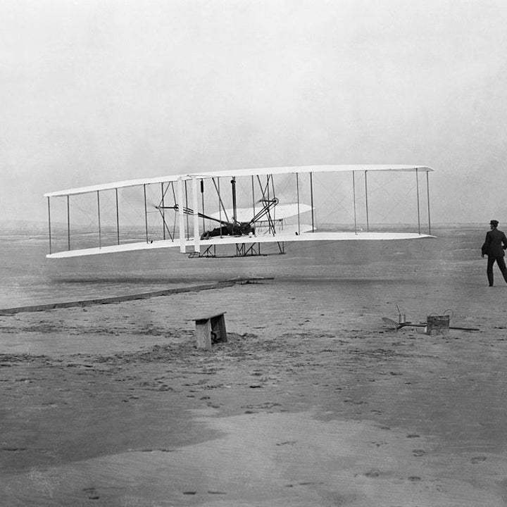 The Wright brothers' historic first flight in the Flyer