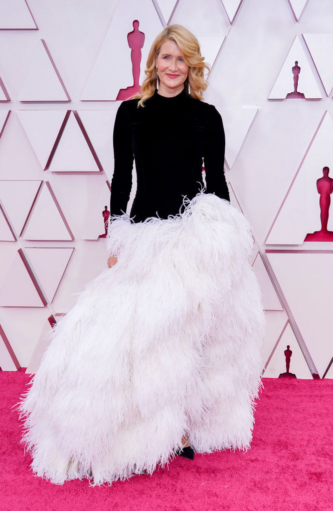 Laura in a feathered gown