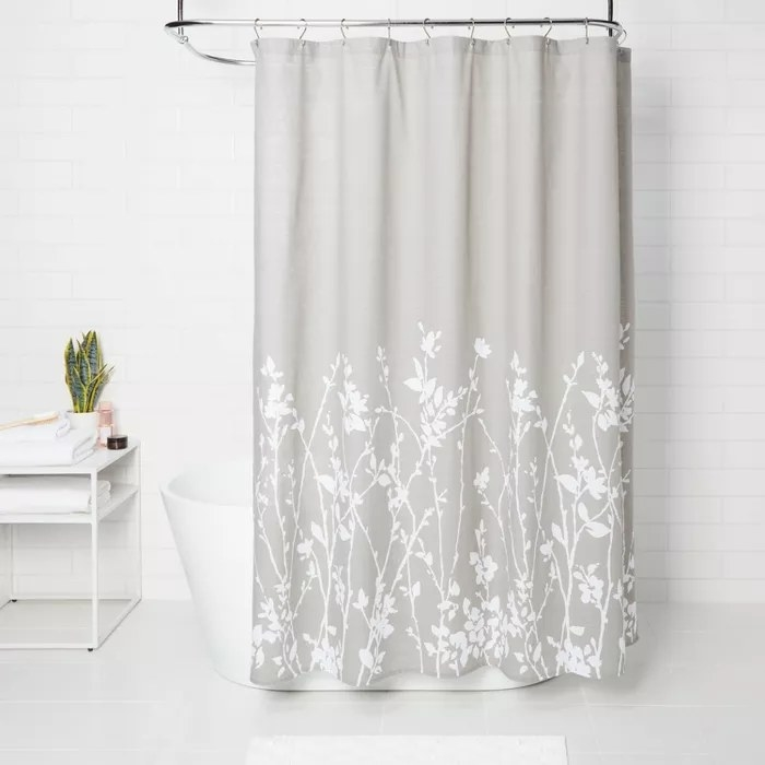 The gray shower curtain