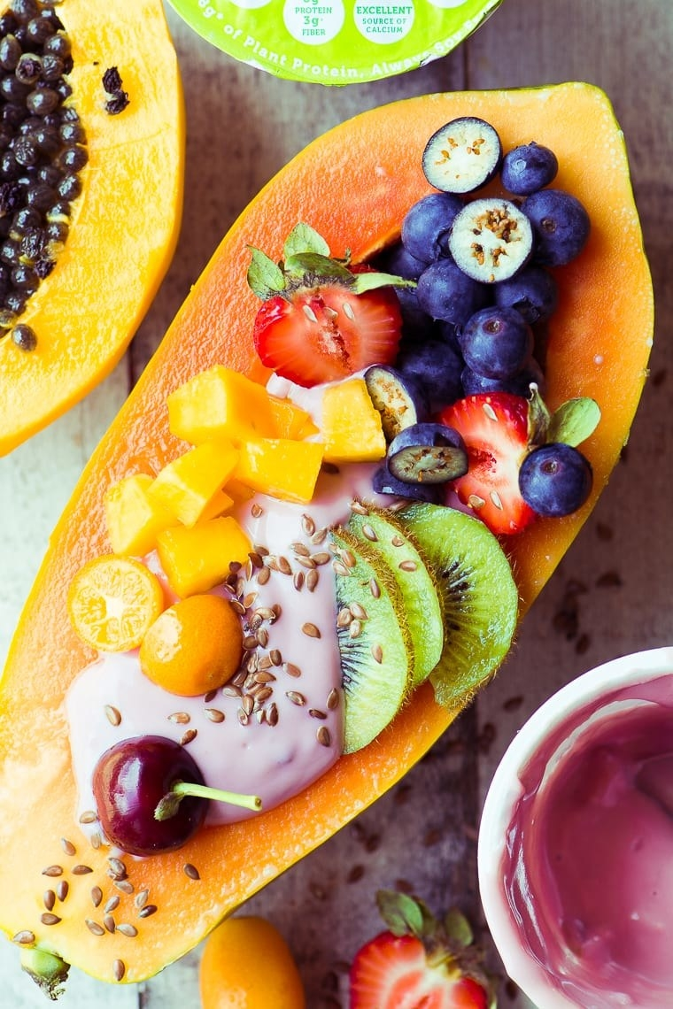 A papaya boat with yogurt and other fruits.
