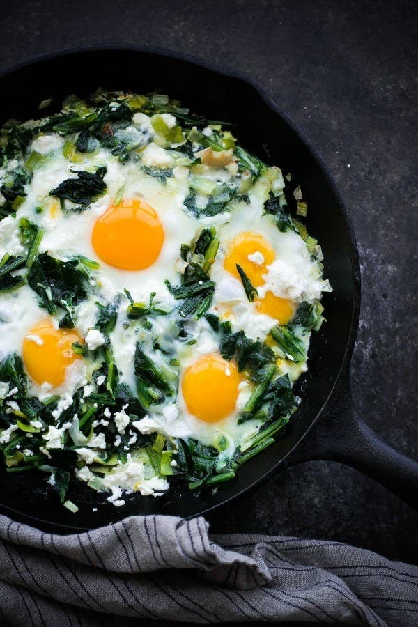 Skillet dandelion greens with baked eggs.
