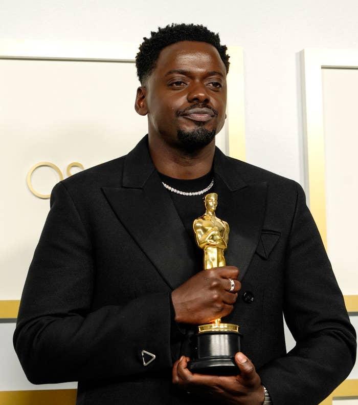 Daniel holding his Oscar backstage