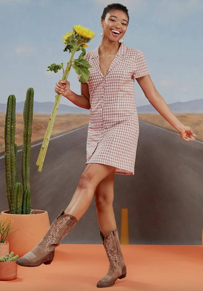 The daytime shirt dress in brown/ white being worn by a model in cowboy boots