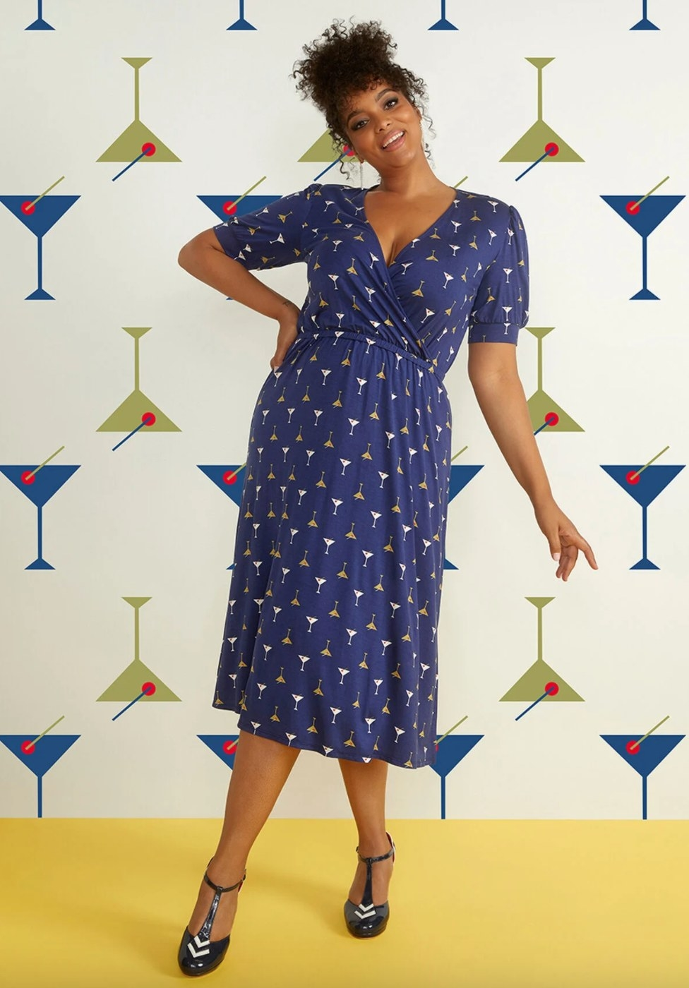 The midi martini dress in navy blue on a model