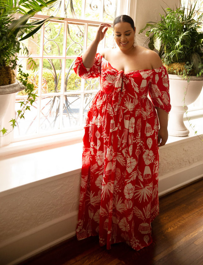 model wearing off-the-shoulder maxi dress in a botanical red print