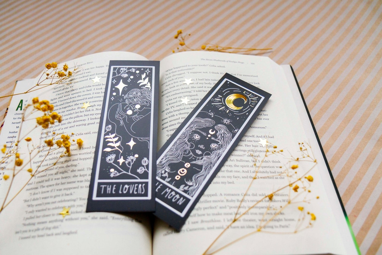 open book with black and metallic bookmarks