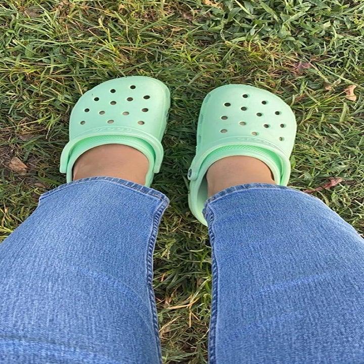 a different reviewer wearing seafoam green crocs