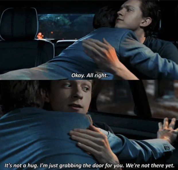Tony Stark hugging Peter Parker in the car