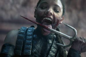 Mileena licking blood off a knife in Mortan Kombat